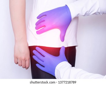 Girl on consultation with a doctor with a sick hip joint, synovitis and bursitis in the thigh, inflammation, osteoarthritis