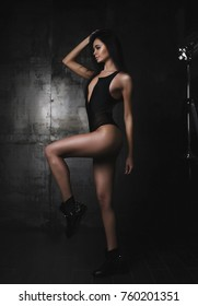 Girl on a dark background in linen
