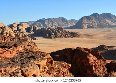 Girl on desert Wadi Rum during sunset