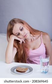 Girl on diet can't eat breakfast, vertical