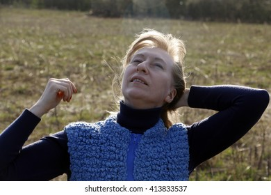 Girl on the field in sunny day