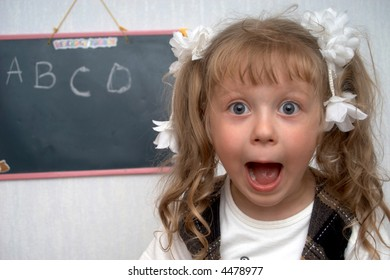A girl on a first lesson at school