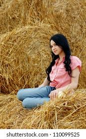 girl on fresh straw at field