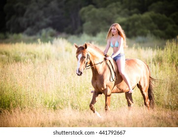 Girl on a horse in a swimsuit