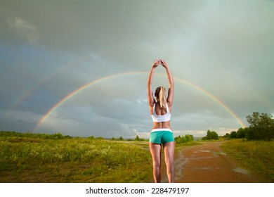 girl on a morning jog in the summer outdoors .Rainbow in the blue sea