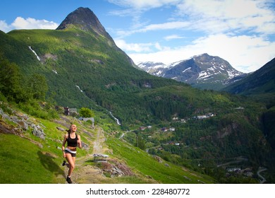 girl on a morning jog in the summer outdoors. Geiranger autumn. scenic landscapes of the northern Norwegian fjords.