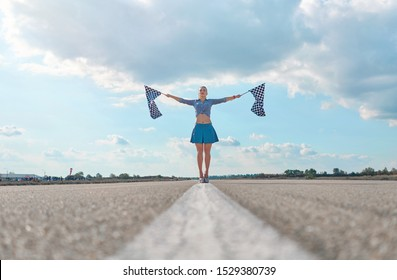 girl on a motorcycle race with starting flags