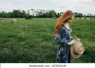 Girl on a pasture