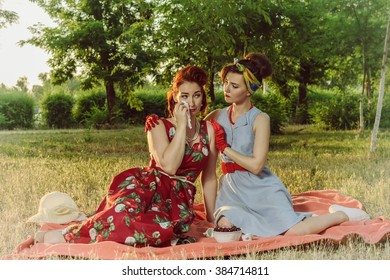 Girl on a picnic and sit gossiping. retro style