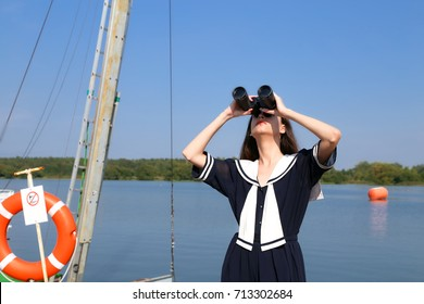 The girl on the pier, looking through binocular,