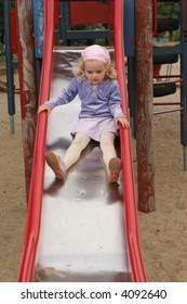 girl on the slide - outdoor activity in preschool