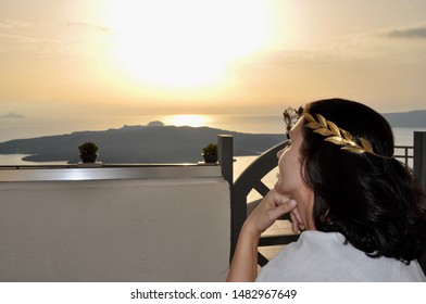 Girl on sunset background in Santorini