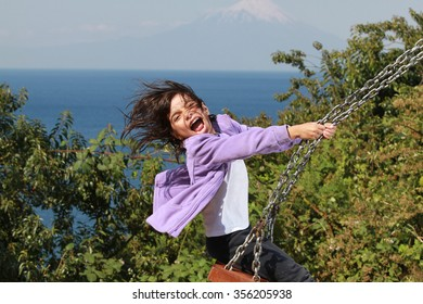 Girl on a swing - Puyehue National Park and Osorno