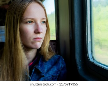 Girl on the train by the window