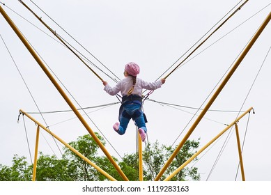 Girl on a trampoline with elastic bands