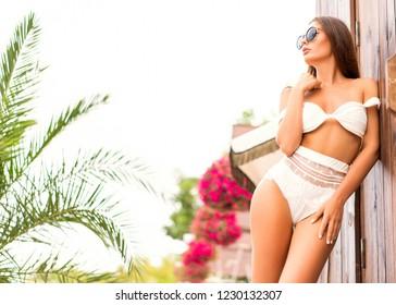 girl on a tropical beach at sunset