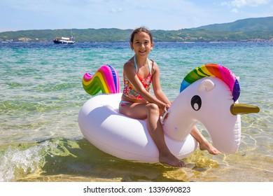 Girl on the unicorn on the sea