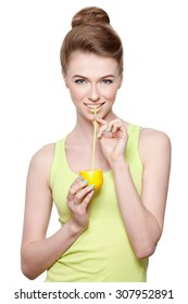 Girl on a white background drinking fresh lemon juice from a straw