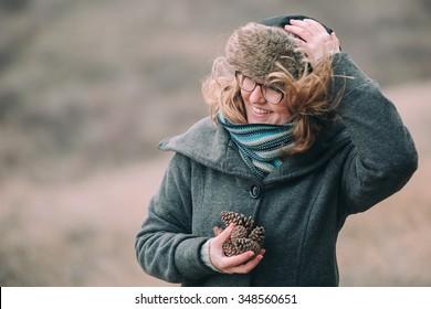 Girl on the wind. Autumn, winter portrait.