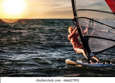 Girl on Windsurfing, Fun in the ocean, Extreme Sport.