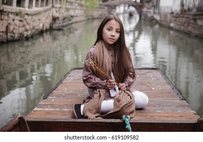girl on a wooden boat