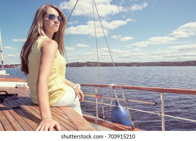 Girl on the wooden deck of the ship. Beautiful blonde