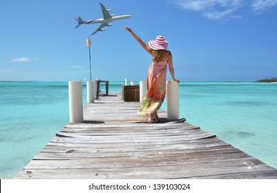 Girl on the wooden jetty. Exuma, Bahamas