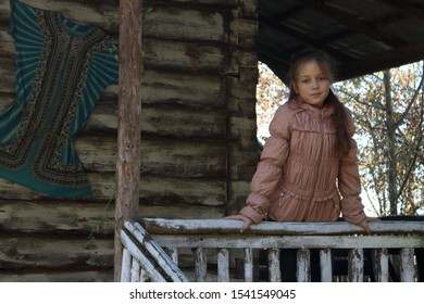 Girl on a wooden porch at home
