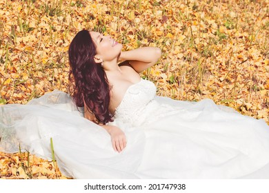 Girl on the yellow leaves field