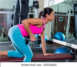 girl one arm dumbbell bent over row on bench workout exercise at gym