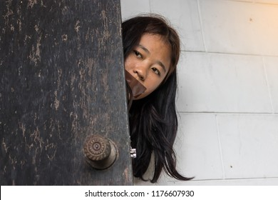 A girl open the door for run away from criminal. Woman sexual violence.
