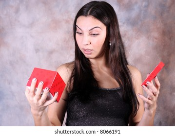 Girl with open gift box, surprised