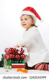 girl opening box with christmas balls
