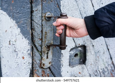A girl is opening the door on the street