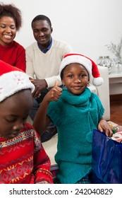 Girl opening her gift, finger up