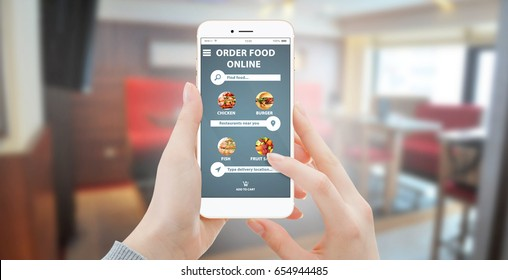 Girl ordering food online on smartphone, with restaurant in background