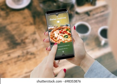 Girl ordering pizza with smartphone, while drinking coffee. Online order food concept