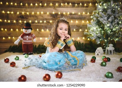 girl in oriental dress sitting at christmas tree