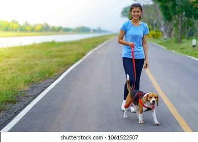Girl outdoors on road with her dog