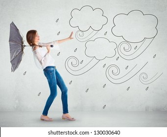 Girl over a white wall, bad weather concept