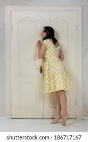girl overhears at the door