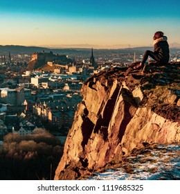 A Girl Overlooking The Beautiful Edinburgh Skyline And Castle During A Winter Sunset