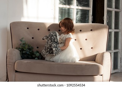 girl with owl is sitting on the sofa