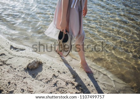 010d99b9f ... Stock Photo (Edit Now) 1107499757 - Shutterstock. Girl with Oxford shoes  on the beach sand