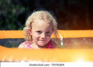 girl in paddling pool