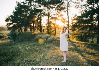 Girl pagan sunset with flowers