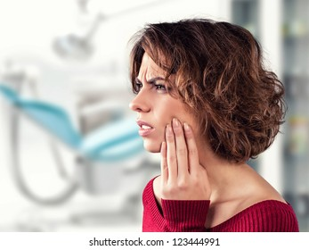 Girl with a painful tooth in a medical office
