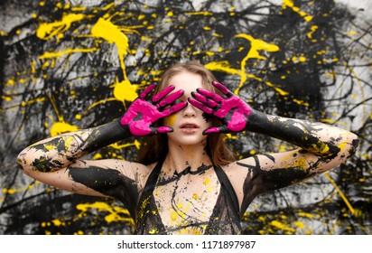 girl in paint, like living palette, joyful mood