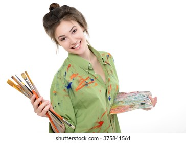 Girl painter drawing portrait with oil paints,  professional painter at work over white background