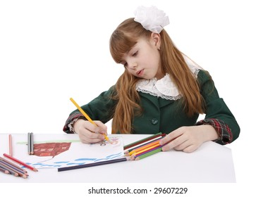 Girl is painting her family in bright colours. School girl is  drawing  in pencil. Isolated over white background.